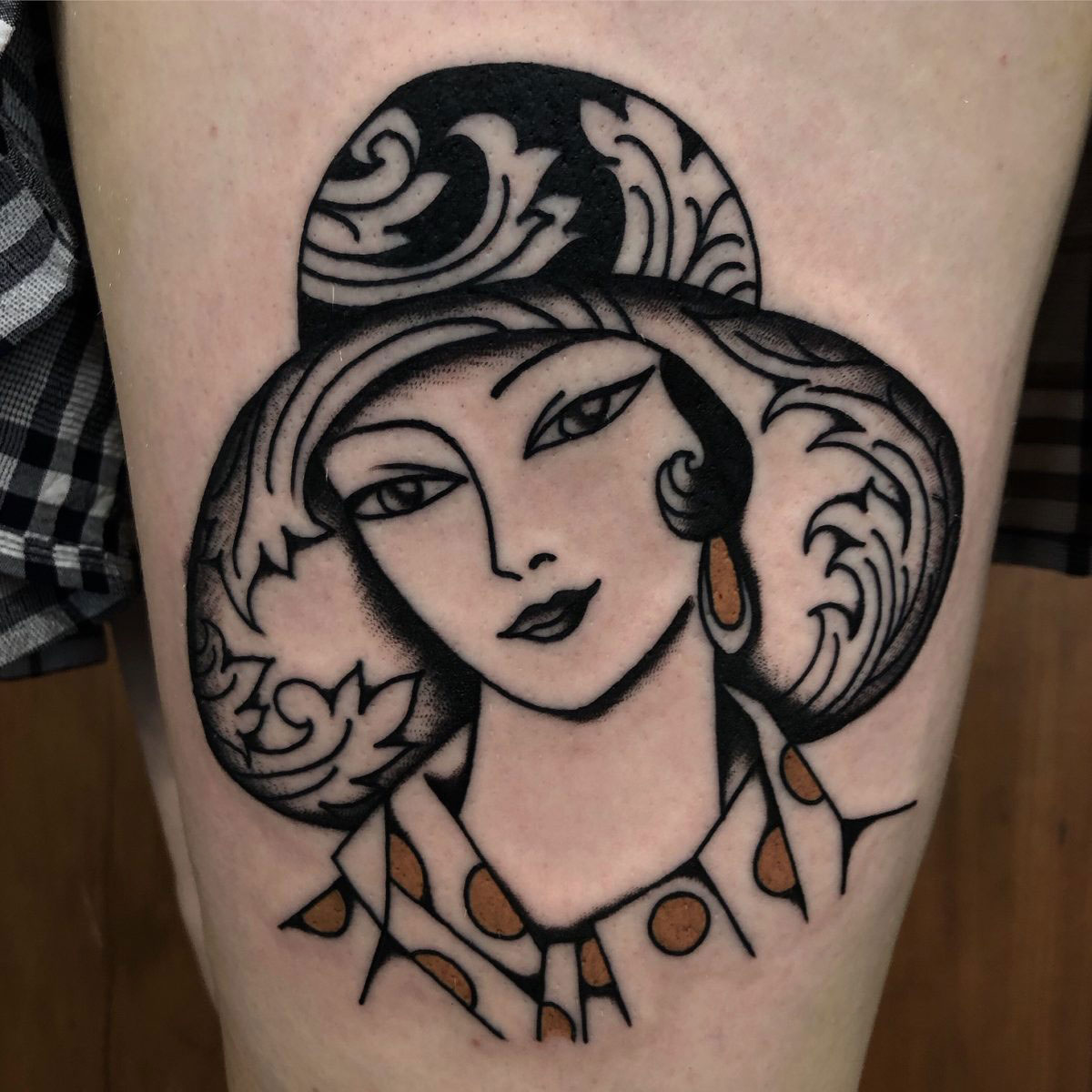 tattoo of vintage beautiful woman with large ornate hat
