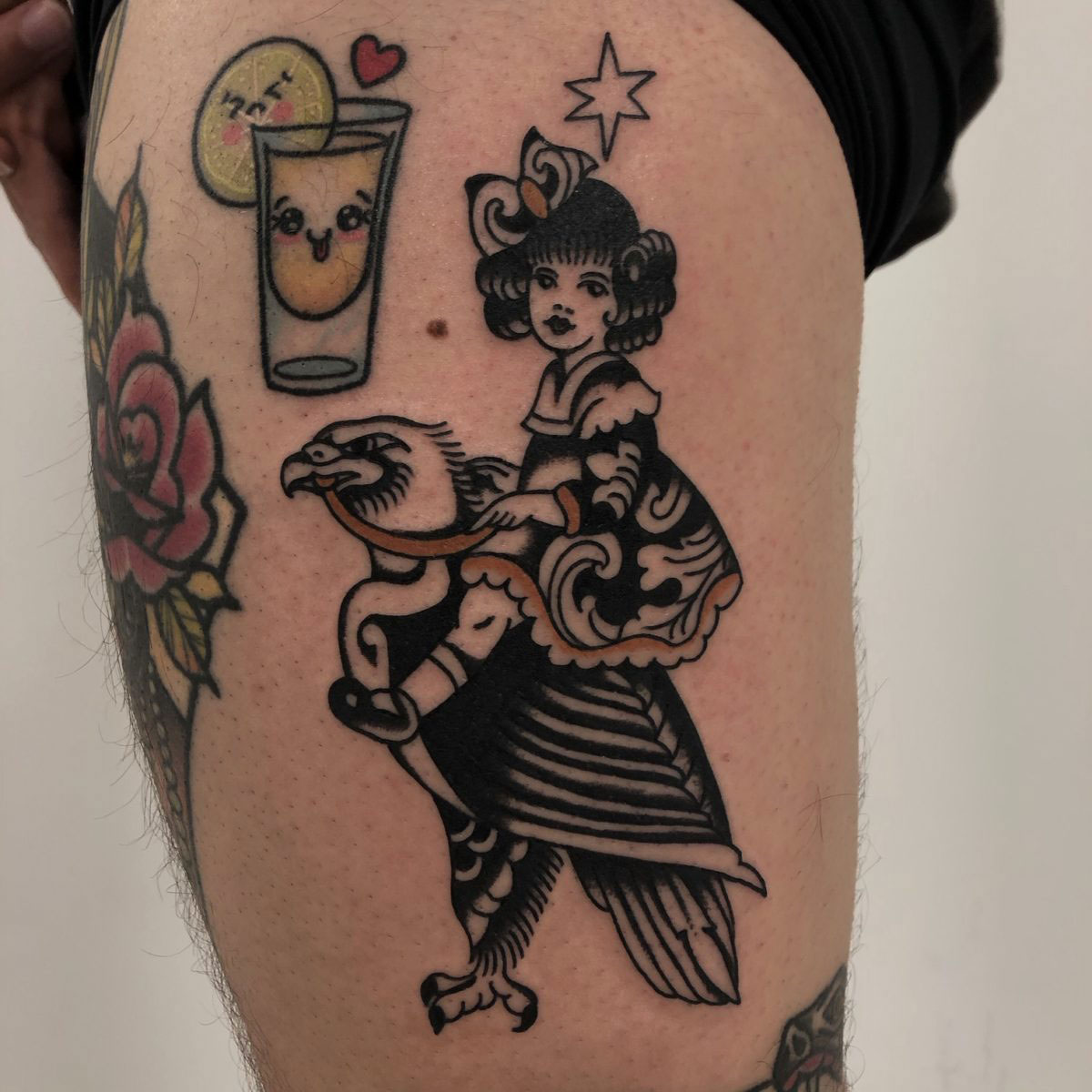 traditional tattoo of a girl riding an eagle with a harness and an ornate art deco dress