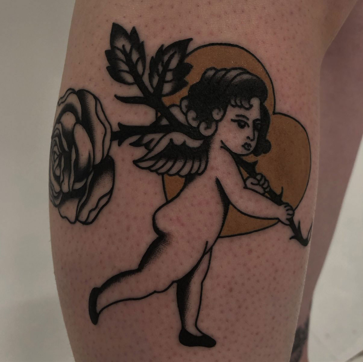 cherub vintage traditional tattoo with heart and rose