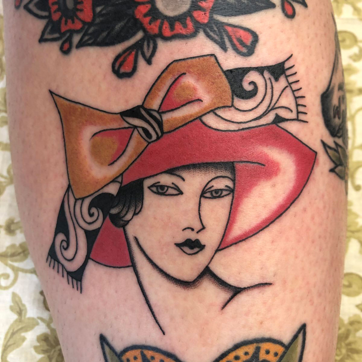 ornate vintage lady tattoo with extravagant hat