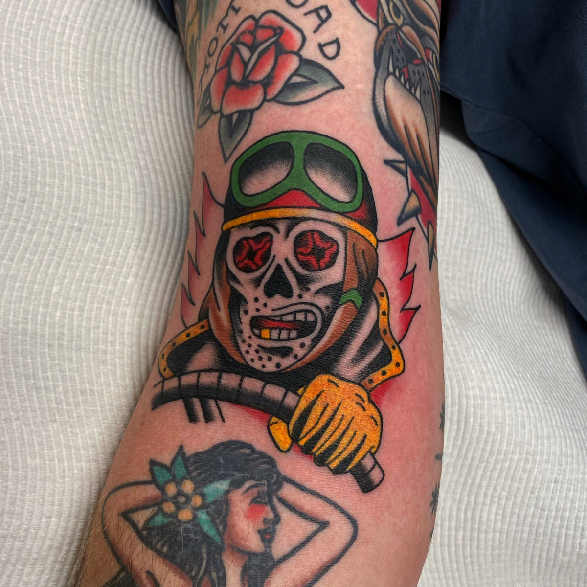 american traditional skeleton pirate tattoo done in colour on the arm