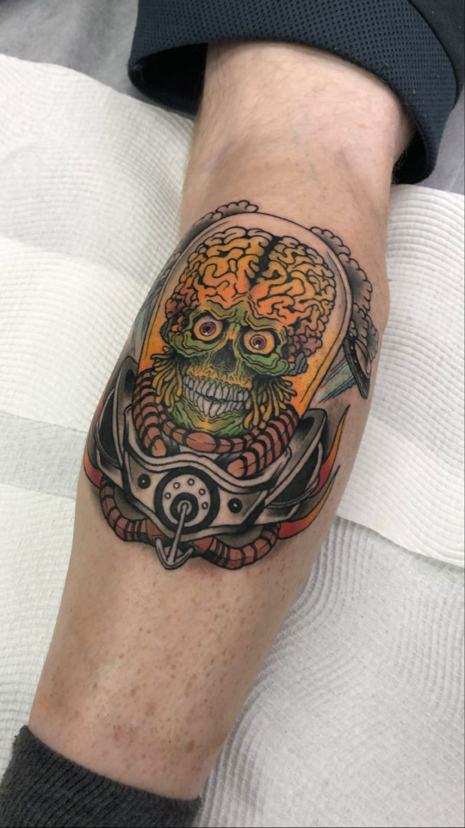 Neo traditional portrait of Mars attacks alien tattooed in colour on calf