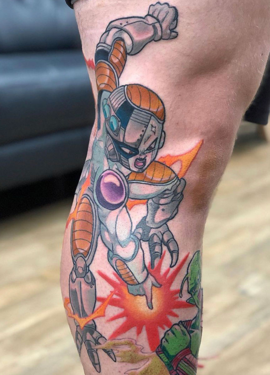 anime tattoo in colour, dragonball z leg sleeve in progress showing Mecha Frieza blasting Piccolo