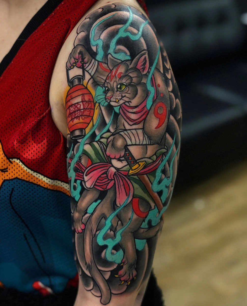 Nekomata Bakeneko two tailed cat spirit japanese tattoo half sleeve, tattooed in colour featuring a gold fish in a lantern and flames