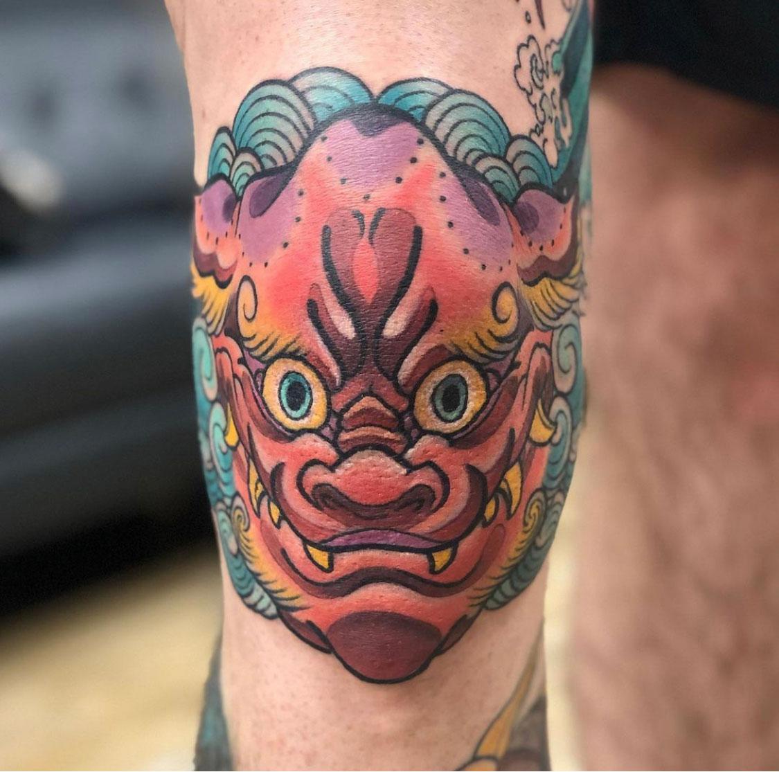 Full colour neo japanese knee tattoo of a karajishi fu dog
