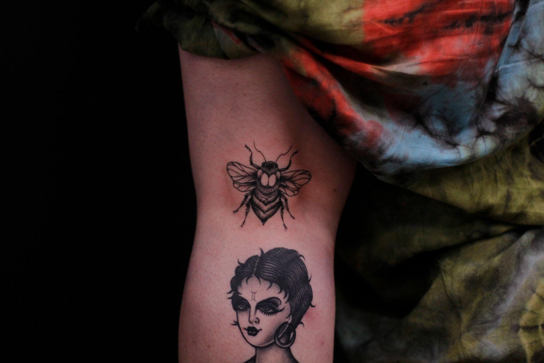 fine line minimalist bee tattoo with dot shading
