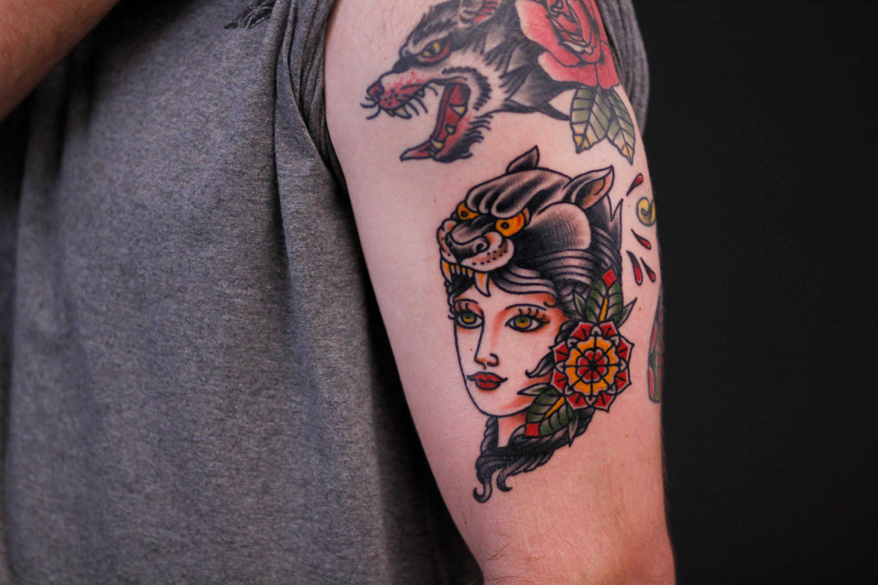 bold classic traditional gypsy lady tattoo with panther on her head and flower beside